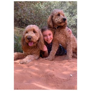 Lydia Ricks (Annie) with two golden doodles