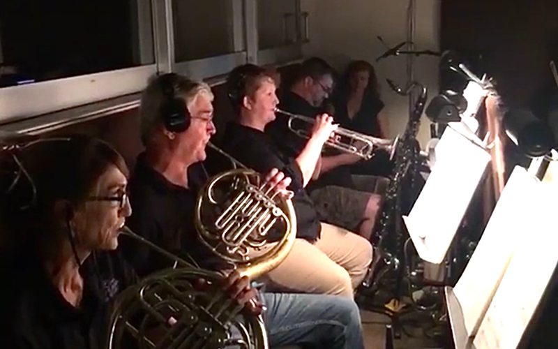 Musicians playing in live orchestra.