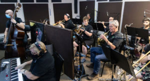 Horn players in the orchestra.