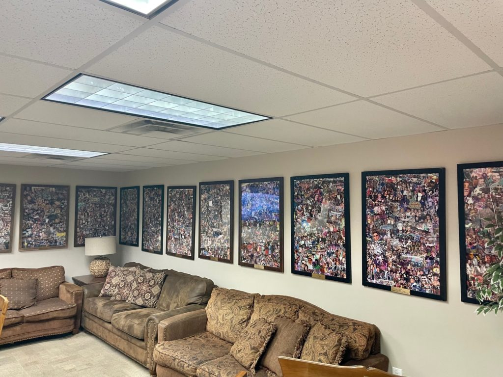Photo collages of cast and crew on display in the green room.